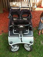 Double valco baby stroller with Joey toddler seat.