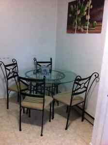 In good condition dining table with 4 chairs