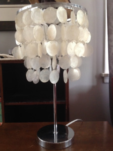 Chrome and shell lamp