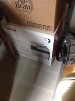 New still in box canon printer that sells for $500 on amazon