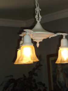 White antique chandelier with etched glass shades