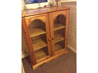 Solid Pine bookcase/display cabinet with glass doors