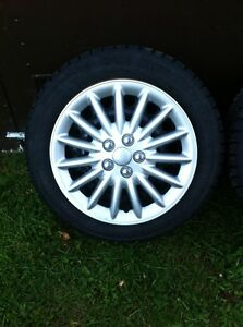 4 - 205/55/16 winter tires , wheels and wheel covers