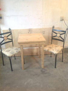 Brand new hand crafted table with two chairs with new cushions
