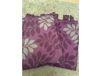 Pair of purple tab top curtains
