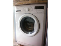 White whirlpool 6KG WASHING MACHINE COMES WITH A FULL WORKING STORE WARRANTY