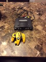 Nintendo 64 with controller, expansion pack and winback