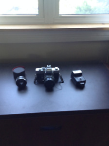 35MM MINOLTA CAMERA, with 2x lens and flash, $40