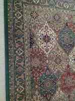Rug - green, taupe, ivory, rust and black patterned