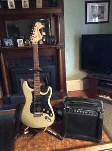 Squire stratocaster by Fender with amp,stand ,and case