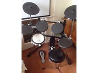 Roland electric drum kit with upgraded snare and peddles
