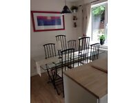 Rennie Mackintosh style glass and iron dining table and 6 chairs