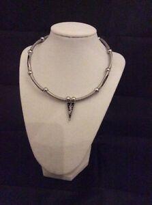 Large hoop earrings necklaces.