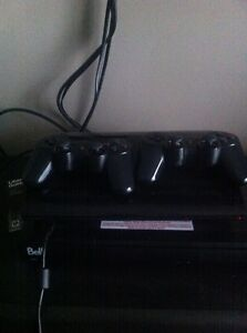PS3 with 2 Remotes and 10 Games