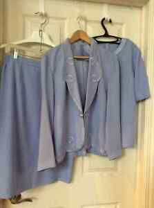 An exquisite 3 pc. Designer suit. Pd. 750.00. Like new.
