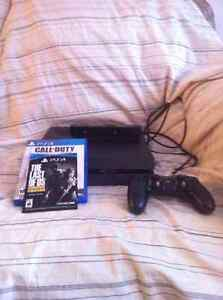 PS4 with controller, 2 games, and PS camera