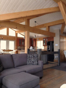 Waterfront Cottage with beach, dock, decks and full amenities