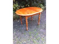 A solid pine extending dining table
