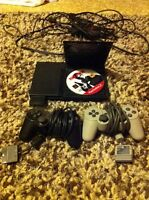 PS2 + 20 games + 3 controllers