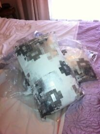 4 brand new in bags oblong cushions grey mix