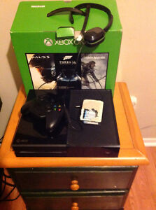 Xbox one with controller battery's headset 79 games on console