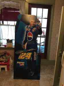 2 Jeff Gordon cut outs and a poster.