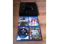 Playstation 4 500GB for sale with 4 games