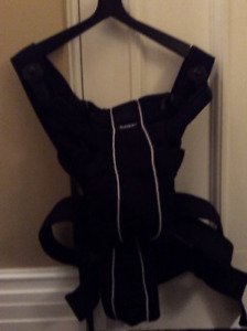 Baby Bjorn baby carrier with hooded cover
