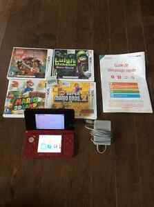 Nintendo 3DS with charger, stylus and 5 games.