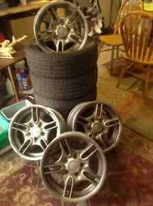 Set of steel rims and all season tires