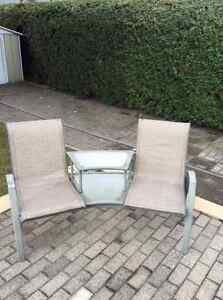 Two seater patio chair with table in-between