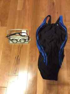 Speedo small one-piece swimsuit and Nike swim goggles