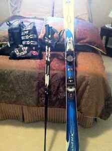 For sale mens downhill skis with bindings and with poles