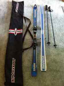 Downhill skis, poles and bag