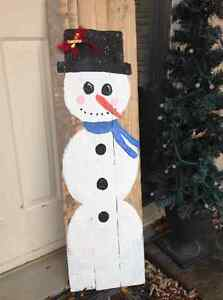 Snowman on reclaimed wood
