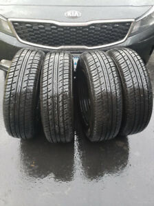 Gently Used All Season Tires with Rims (4)