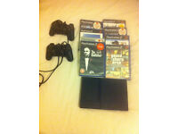 Playstation 2 slim with 8 games, 2 controllers
