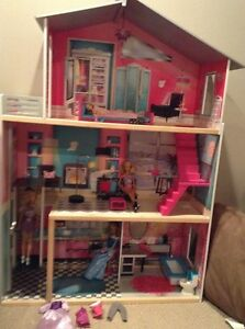 Doll house, barbies, and accessories