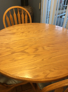 Solid oak dining table, leaf, chairs. Reduced moving must sell