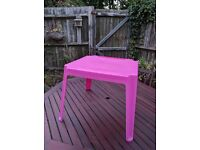 Pink plastic table