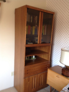 Glass fronted storage cabinet with drawers