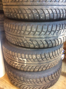 225/65R17 winter/studded tires on rims (never too early to have!