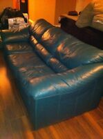 Two green leather couches