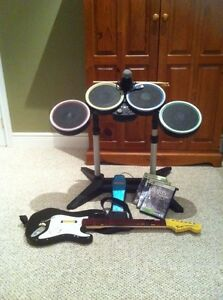 Rock band two. Xbox 360. Plus games. $125