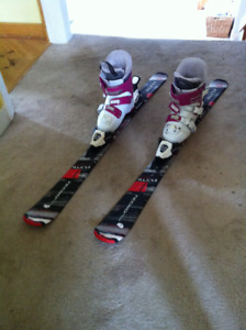 2 pairs of ski and ski boots for kids