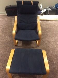 Navy blue IKEA poang chair with footstool
