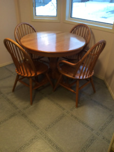 Pedistal oak table with 4 chairs. & wrought iron glass top table