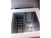 BRAND NEW CHEST FREEZER COMES WITH A WARRANTY