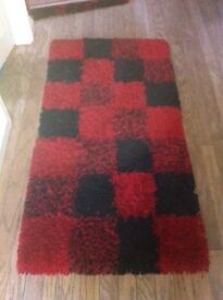 Red and black rug