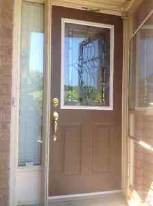 Insulated metal entry door with half glass decorative insert